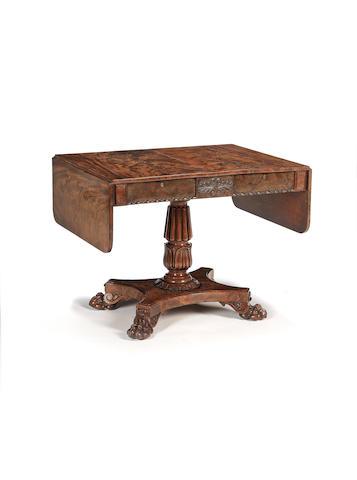 A late Regency flame mahogany sofa table probably Scottish