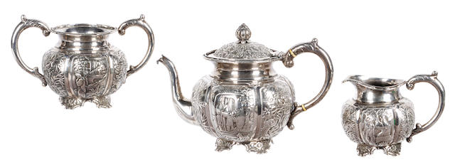 A Chinese silver three piece tea set, late 19th century