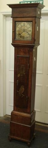 "An 18th Century 30 hour longcase clock, the case with alterations, the square hood carved with initials and date '1754', the long moulded trunk door decorated with two owls, the 9"" square brass dial engraved to the centre with two birds and stylised leaves, the single train movement striking on a bell, 204cm."