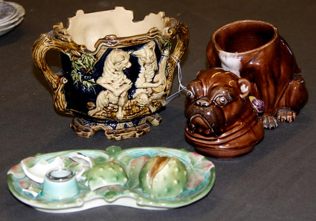 A French majolica novelty inkstand, an English majolica pug dog tobacco box and a continental majolica jardiniere, late 19th century
