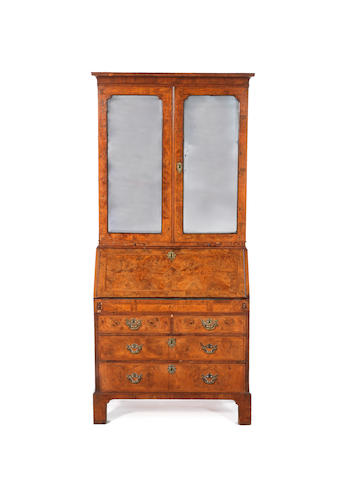 A George II walnut crossbanded and featherbanded bureau cabinet