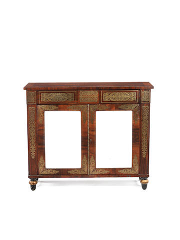 A Regency rosewood, brass marquetry and parcel gilt side cabinet