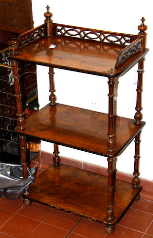A Victorian walnut three tier whatnot,