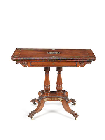 A Regency rosewood and brass inlaid card table