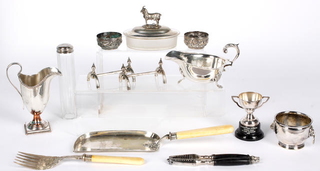 An Indian circular silver salver, embossed with animals, 31cm diameter; and sundry electro-plate to include:a late Victorian shaped oval entree dish and cover, on matching warming dish; a cruet stand with odd bottles; a fruit stand etc.. (parcel)