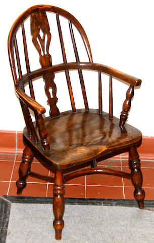 A 19th Century child's yew and elm Windsor elbow chair