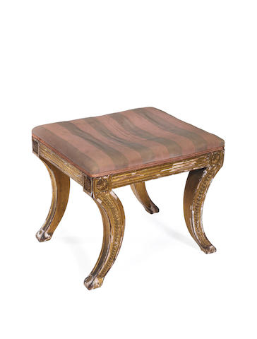 A late George III carved giltwood stool