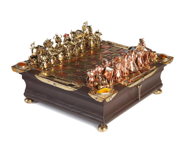 A figural art metal chess set and boardby Andrzej Nowakowscy, Warsaw, Poland