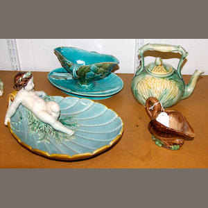 An English majolica serving dish, a Luneville sauceboat, a teapot and cover and a cream jug, late 19th century