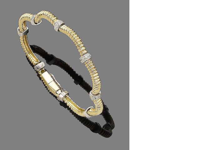 A gold and diamond-set bracelet,
