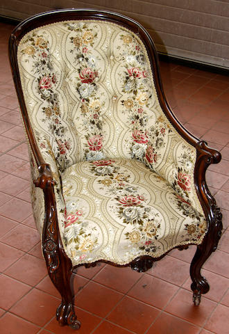 A Victorian rosewood framed buttoned armchair