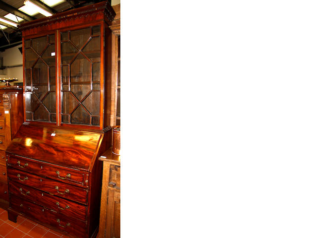 A George III and later mahogany bureau bookcase