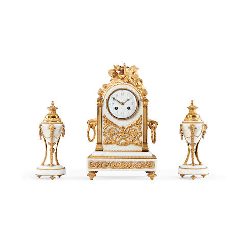A last quarter 19th century French gilt bronze and white marble clock garniture
