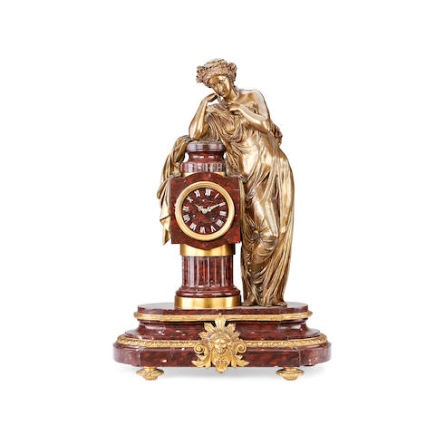 A large third quarter 19th century French bronze, gilt and Rouge Griotte marble figural clock