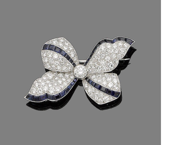 A diamond and sapphire bow brooch