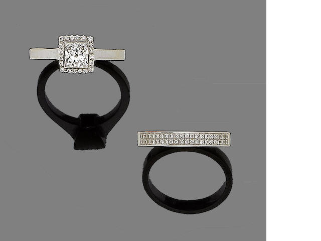 An 18 carat white gold diamond ring, central square cut stone 1.08 carat (2)