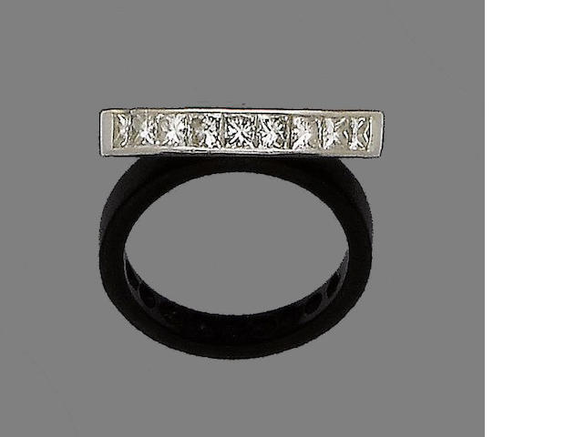 A diamond half-hoop ring,