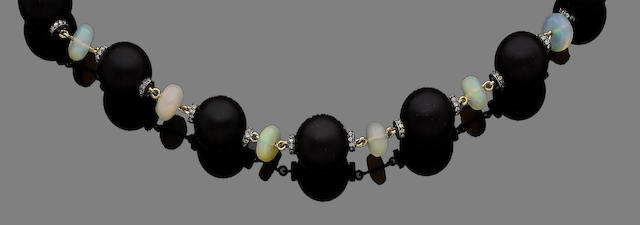 An onyx, opal and diamond necklace