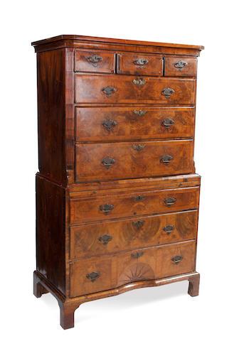 An 18th century walnut chest on chest with sunburst motif