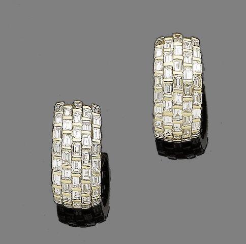 A pair of diamond earhoops, by David Morris