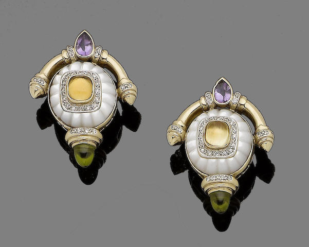 A pair of mother-of-pearl and multi gem-set earclips
