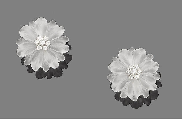 A pair of rock crystal and diamond flower earclips