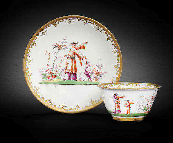 A Meissen or Du Paquier Hausmaler teabowl and saucer, circa 1720-30