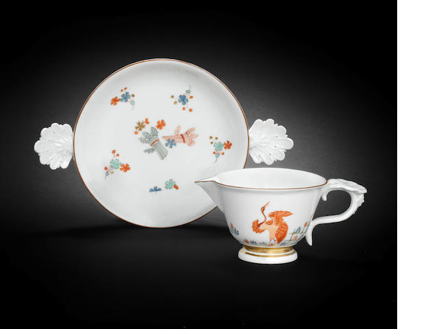 A Meissen spouted cup and saucer circa 1728