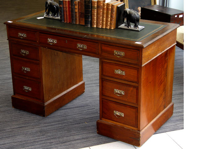A late Victorian/Edwardian straight-grain walnut pedestal desk