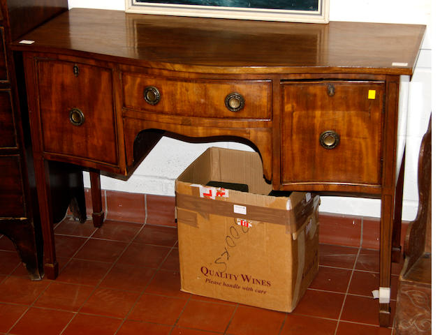A  mahogany serpentine front sideboard of small proportions Early 20th Century