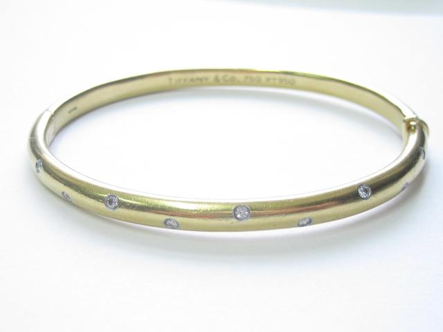 An 18ct gold diamond 'Etoile' bangle,  by Tiffany & Co.,
