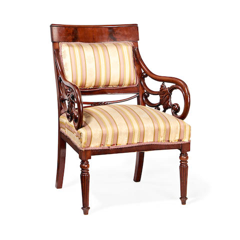 An unusual mahogany library armchair of large proportions