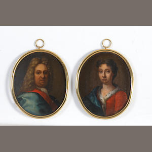 English School, circa 1710 A pair of miniatures portraying a Gentleman and a Lady: the former, wearing blue cloak folded back to reveal scarlet lining, white stock and lace chemise, his long curling wig powdered; the latter, wearing scarlet dress edged with ermine, a dark blue mantle draped over her right shoulder, her brown hair partially upswept and curled