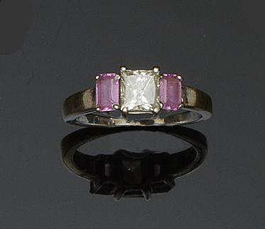 A diamond and pink sapphire three stone ring