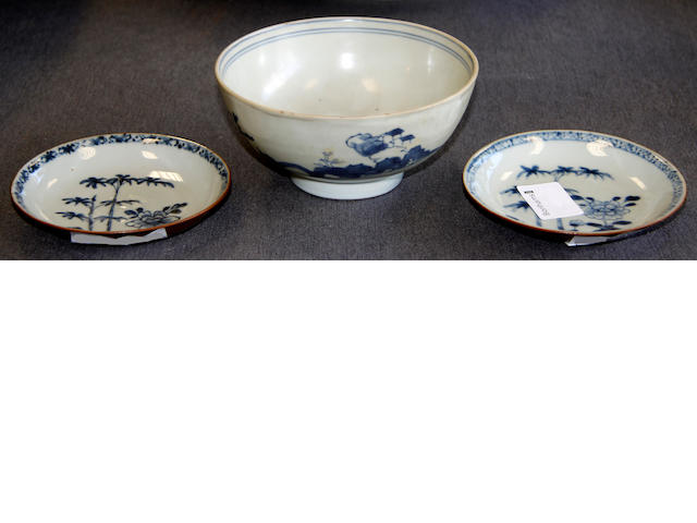 A pair of 18th Century blue and white saucers