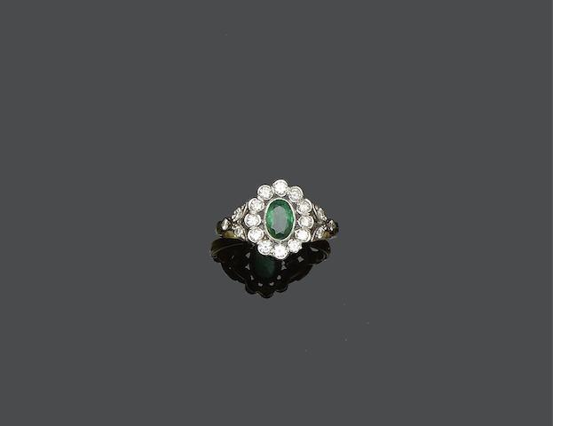 An Edwardian style emerald and diamond cluster ring