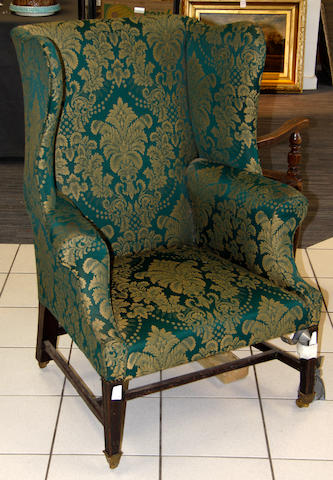 A George III style mahogany wing back armchair
