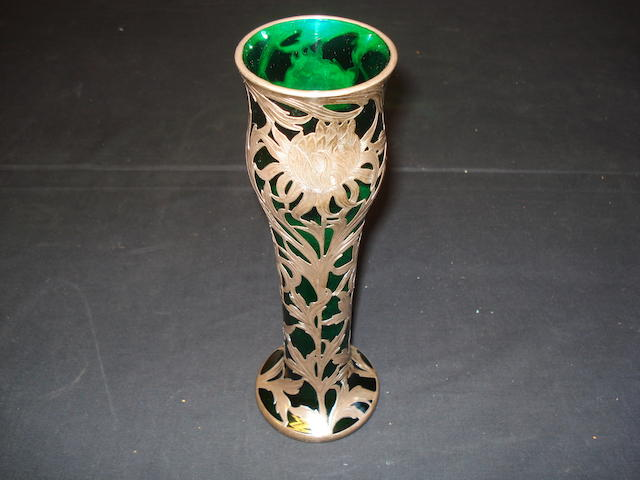 A late 19th Century green glass and silver mounted vase