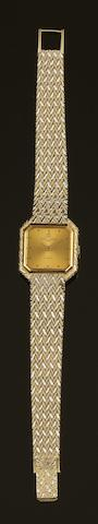Baume & Mercier: An 18ct gold quartz bracelet watch length 18.3cm.