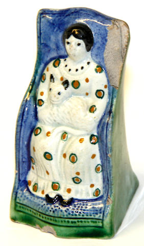 A Prattware figure of a seated woman
