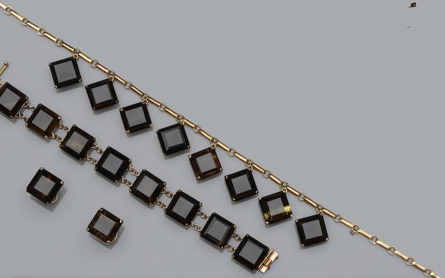 A smoky quartz bracelet, necklace, ring and earring suite, and a smoky quartz pendant necklace (5)