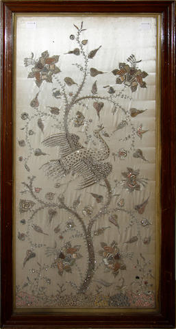 A framed Indian embroidered panel