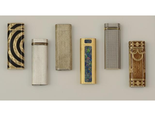 A collection of six cigarette lighters