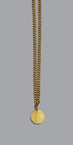 A half sovereign on curb-link chain