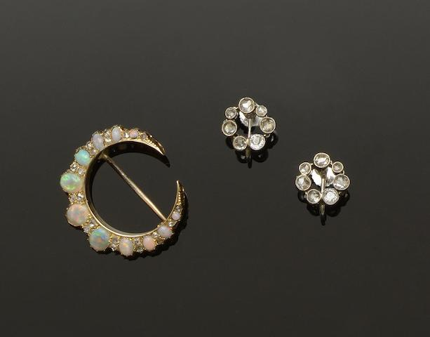 A Victorian opal and diamond crescent brooch and a pair of diamond ear hoops (2)