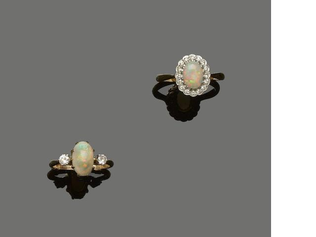 Two opal and diamond rings and a ruby dress ring (3)