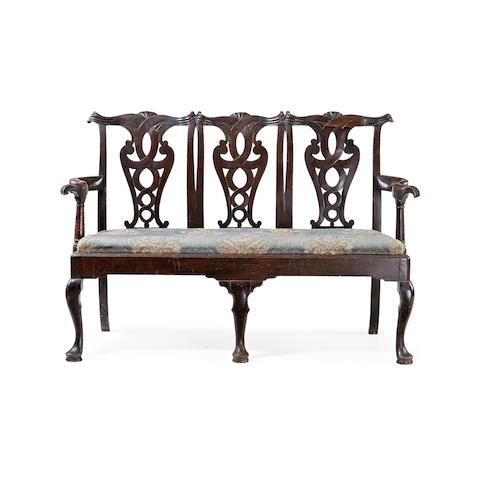 A George II style mahogany triple-chairback settee