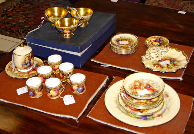 A collection of twenty nine pieces of Aynsley fruit painted china, to include a cased set of six coffee cans and saucers by D Jones, three trios, preserve jar, a plate, shell shape dish, circular pedestal dish and four small dishes.