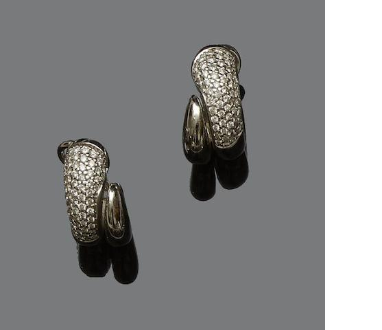 A pair of diamond set ear hoops