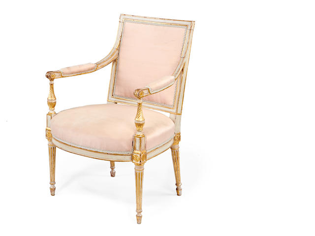 A George III painted and parcel gilt open armchair in the manner of B. Harmer
